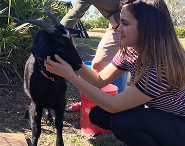 Visitor with Goat